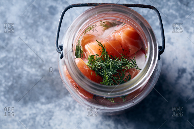 Pickled salmon pieces in jar
