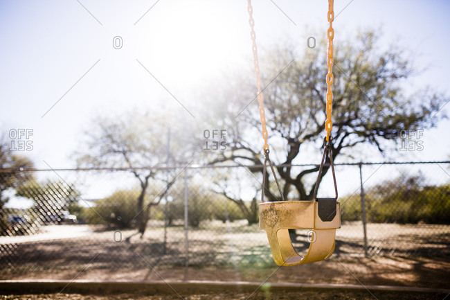 Empty bucket swing at a playground