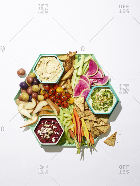 Crudite platter with prepared fruits and vegetables and dipping sauces