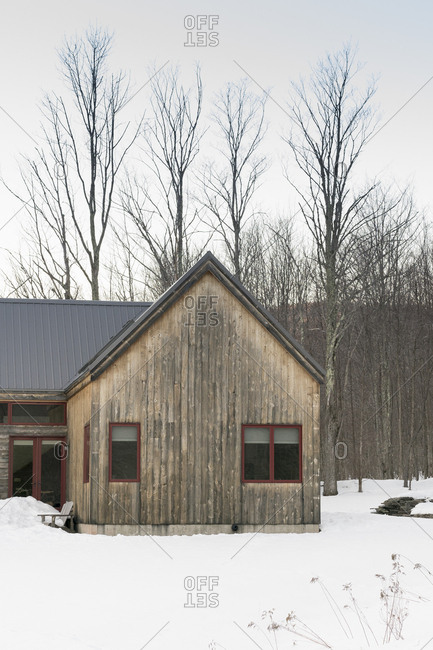 Wood home in rural winter setting