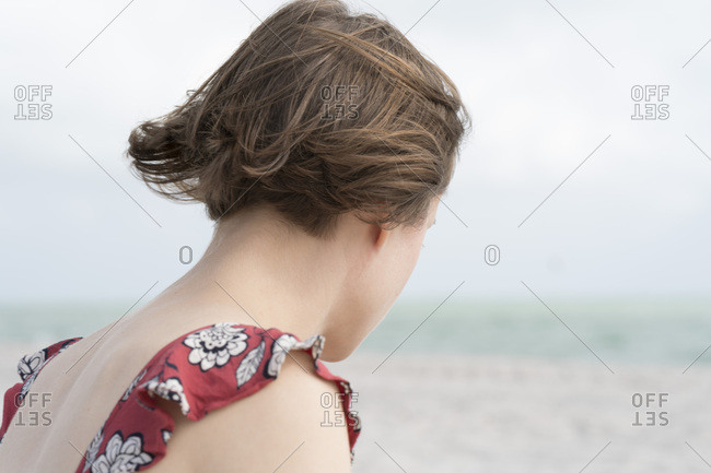 Brown haired woman in coastal breeze