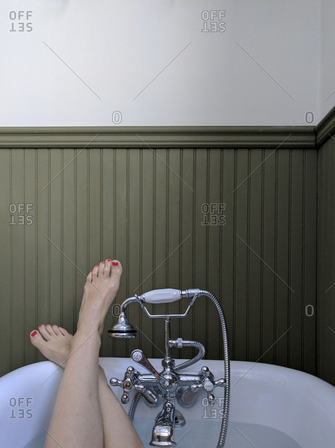 Woman's feet as she lies in tub