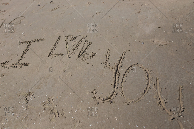 """I love you"" written in the sand"