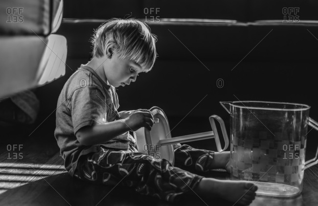 Boy playing with water pitcher