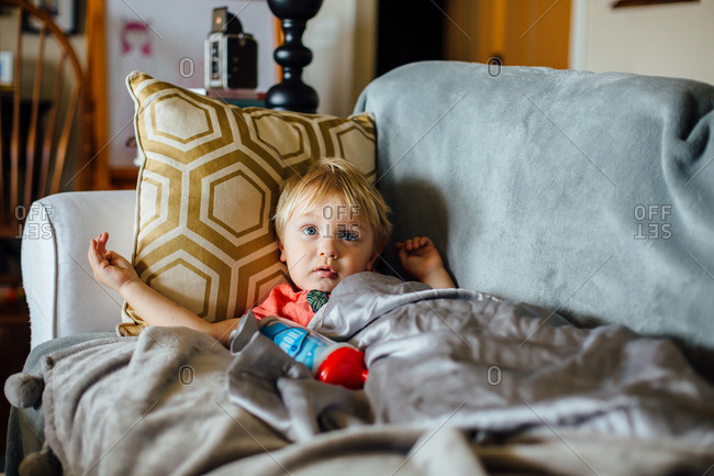 A sick toddler on couch
