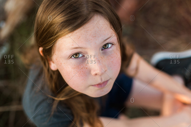 Girl with hazel eyes and freckles