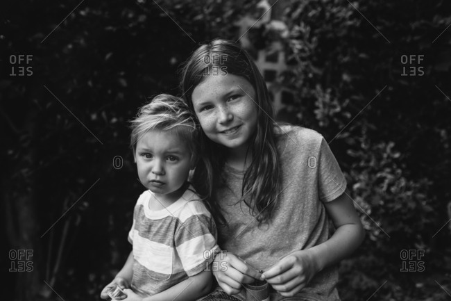 Two kids in backyard together