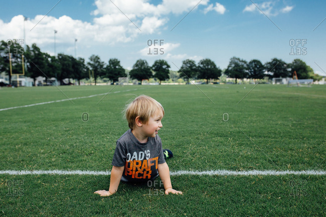 Smiling toddler on football field