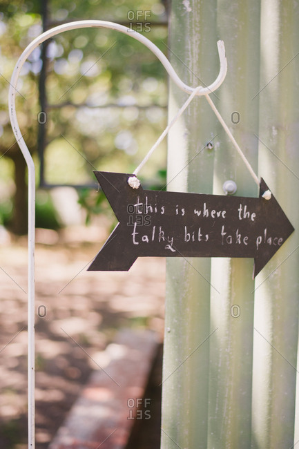 """Wedding sign reading """"This is where the talky bits take place"""""""