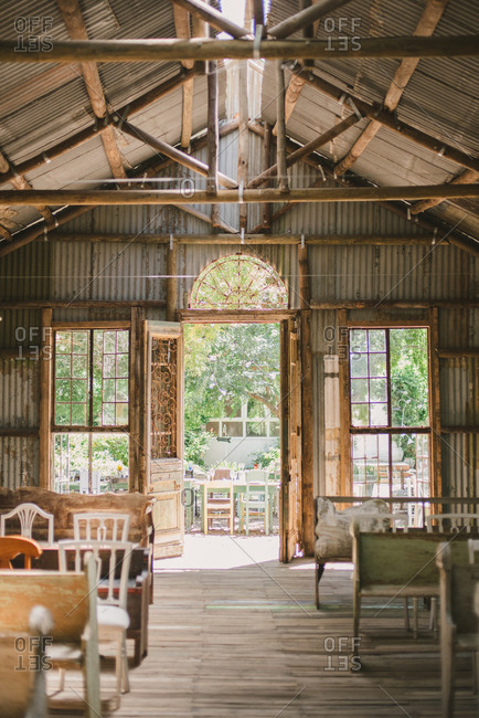 Open doors of barn set up for a wedding ceremony