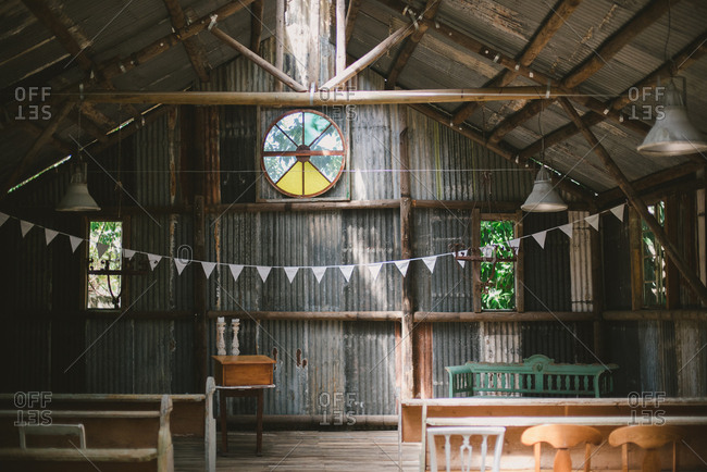 Barn interior set up for wedding ceremony