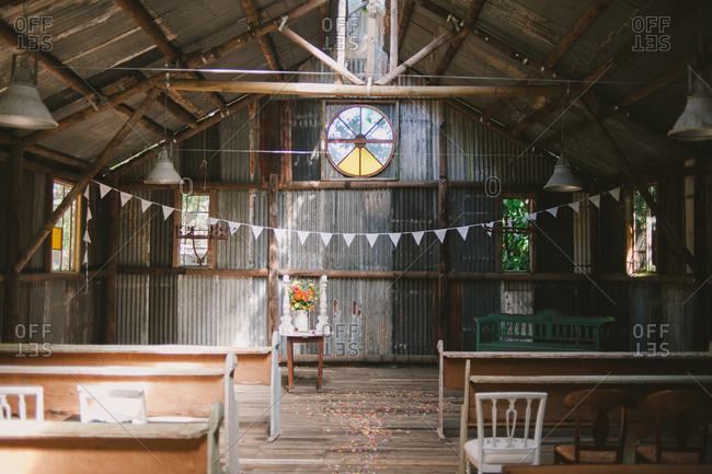 Interior of a barn set up for wedding ceremony