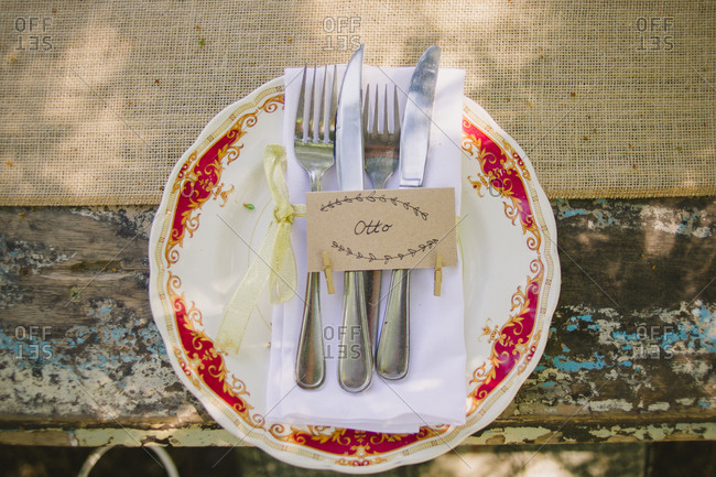 Place setting on rustic wood outdoor wedding table