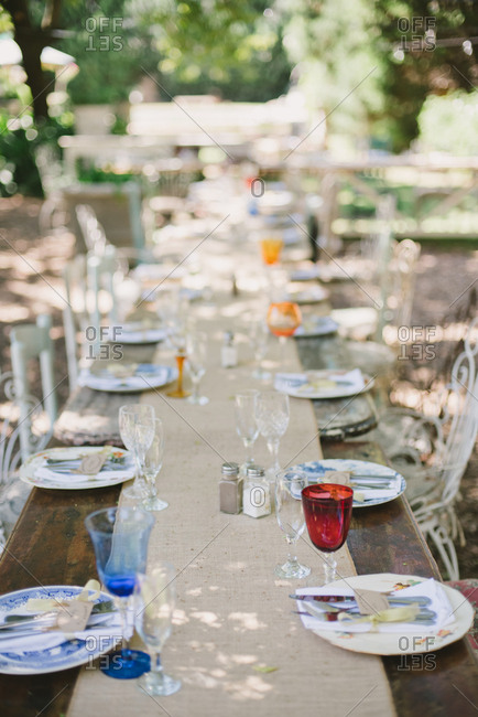 Long outdoor table set for a wedding