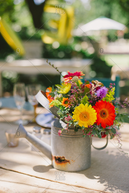 Colorful floral arrangement in a watering can