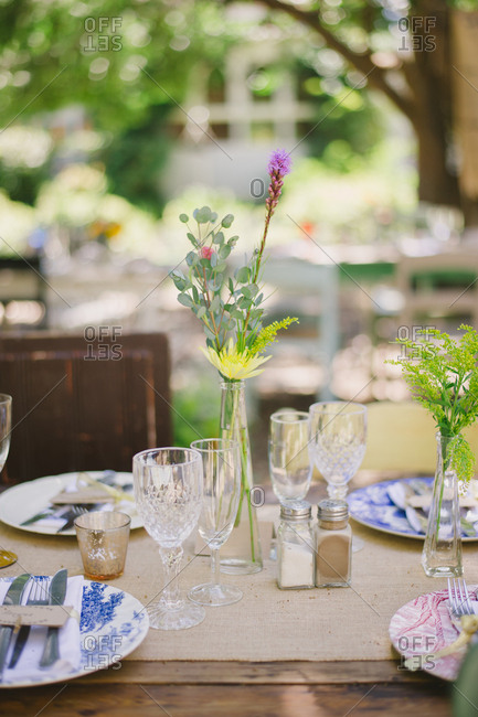 Small floral arrangement on an outdoor wedding table
