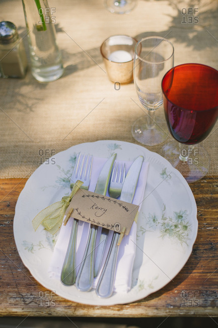 Overhead view of plate with a nametag on outdoor wedding table