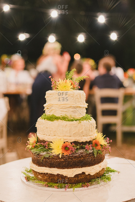 Wedding cake decorated with frosting and flowers
