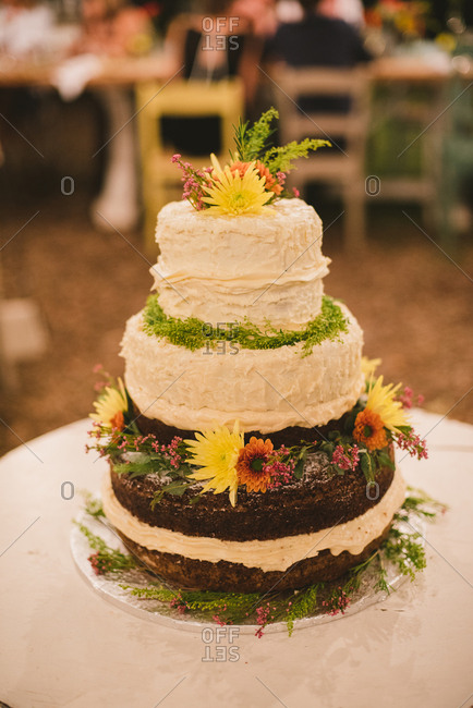 Wedding cake with frosting and flowers