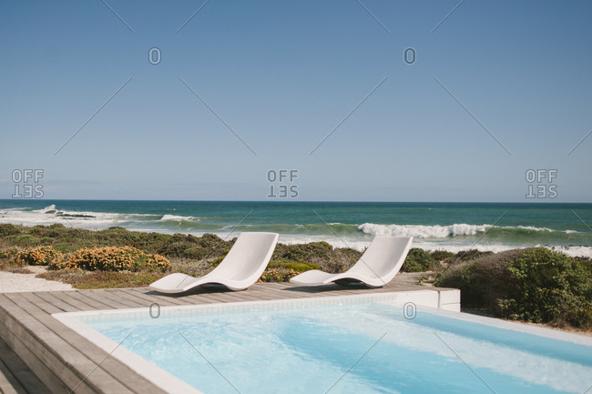 Lounge chairs by a pool in Langebaan, South Africa