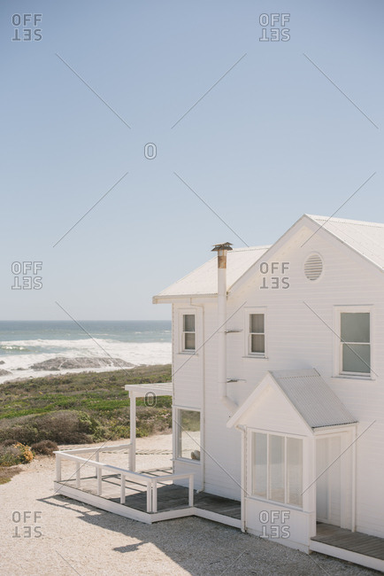 View of the ocean and a beach house in Langebaan, South Africa