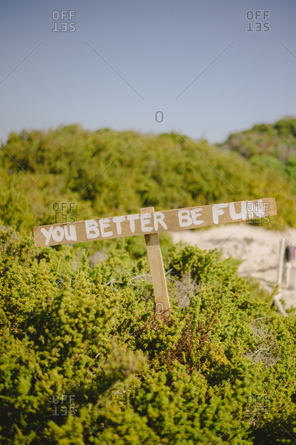 "Wedding sign reading ""You better be fun"""
