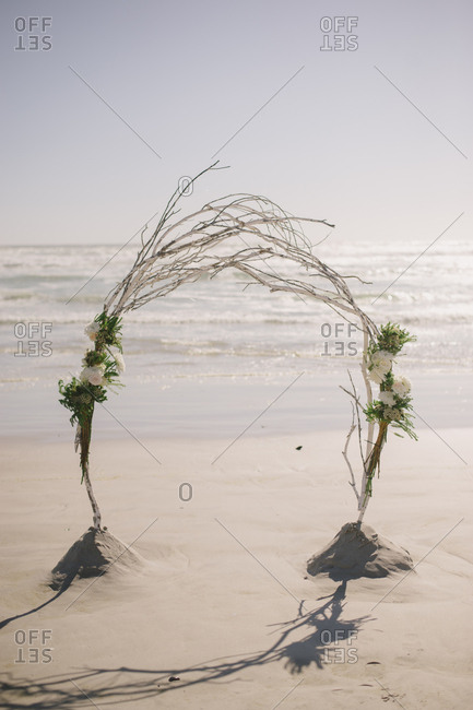 Arbor made from tree branches and flowers on the beach in Langebaan, South Africa