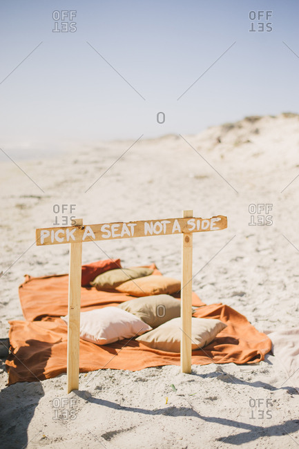 """Wedding sign reading """"Pick a seat not a side"""" on the beach in Langebaan, South Africa"""