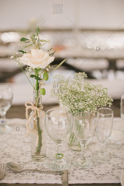 Wine glasses by flowers