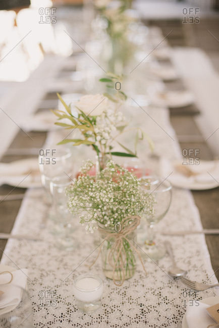 Set table at a beach wedding reception