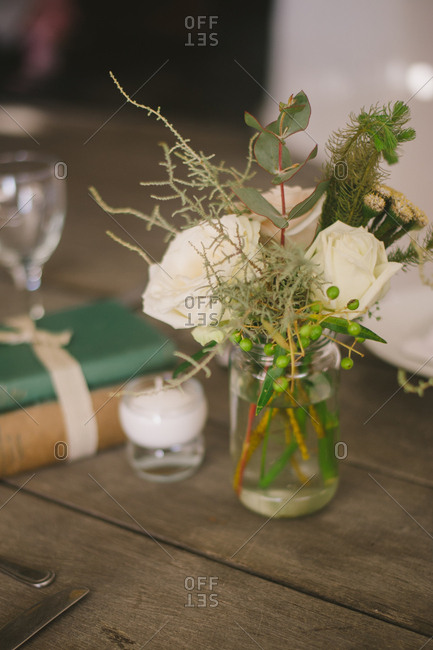 Wedding floral arrangement on a wooden table