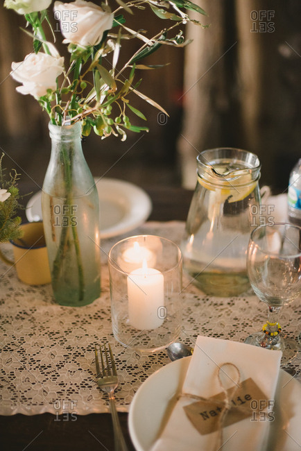 Lit candle on a set wedding table