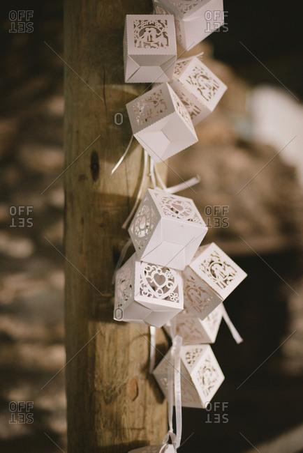 White boxes tied to a wooden post