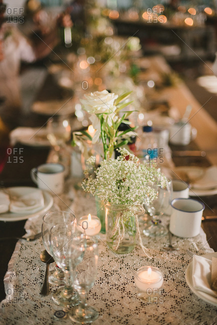 Set wedding table with roses and baby's breath centerpieces