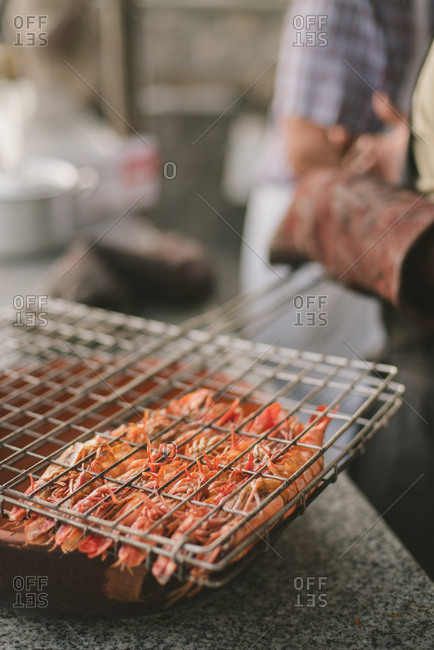 Chef grilling shrimp at an outdoor wedding reception