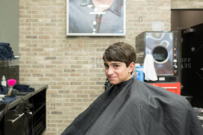 Boy smiling in barbershop