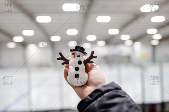 Child holding a snowman decoration