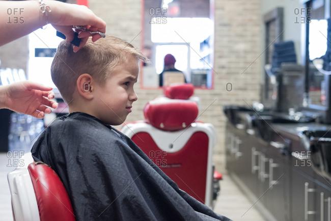 Blonde boy getting a haircut