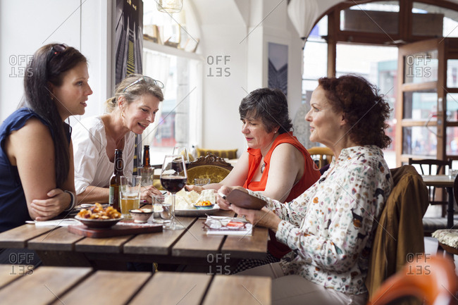 Businesswomen talking during lunch in restaurant