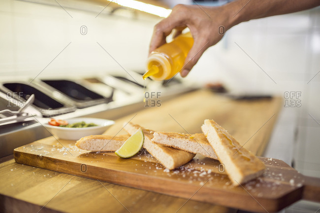 Chef preparing appetizers in commercial kitchen