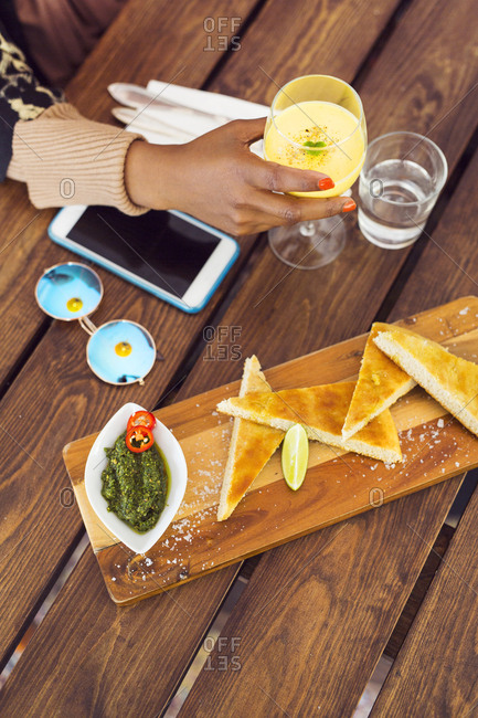 Appetizer and juice in front of businesswoman