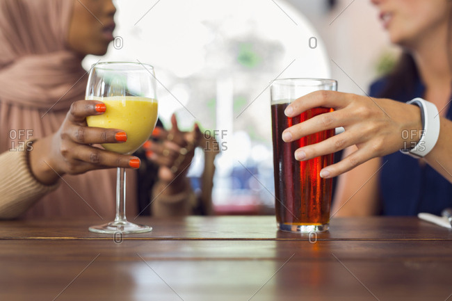 Businesswomen talking and drinking juice
