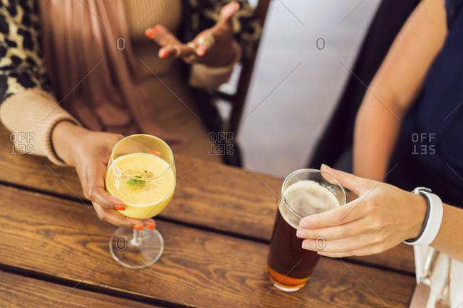 Businesswomen talking and drinking juice