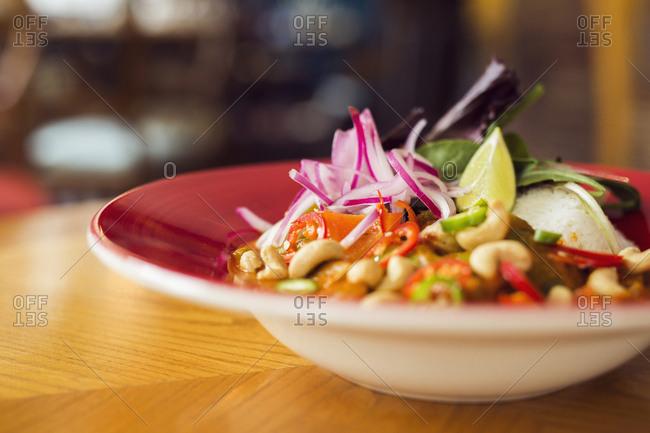 Vegetarian sauce with cashews and salad
