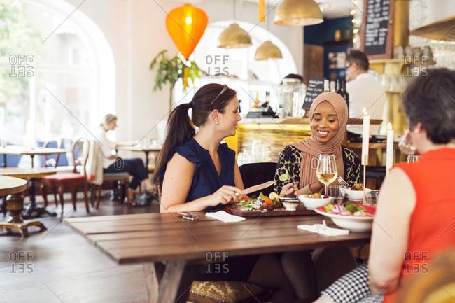 Businesswomen during lunch in restaurant