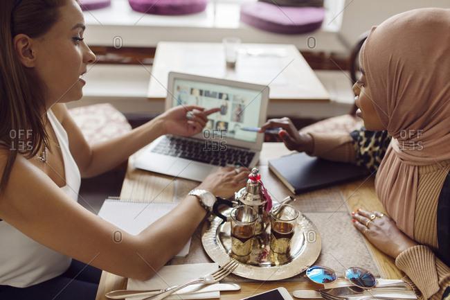 Businesswomen working in tea room