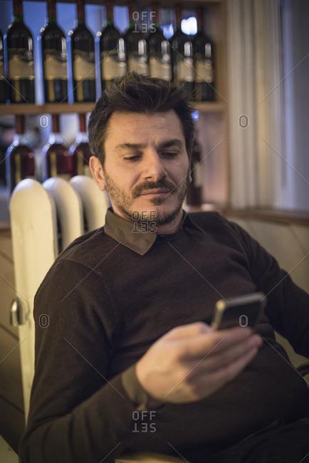 Caucasian man using cell phone