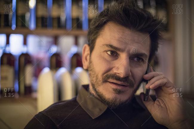Caucasian man talking on cell phone