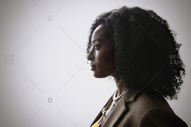 Profile of woman with curly hair