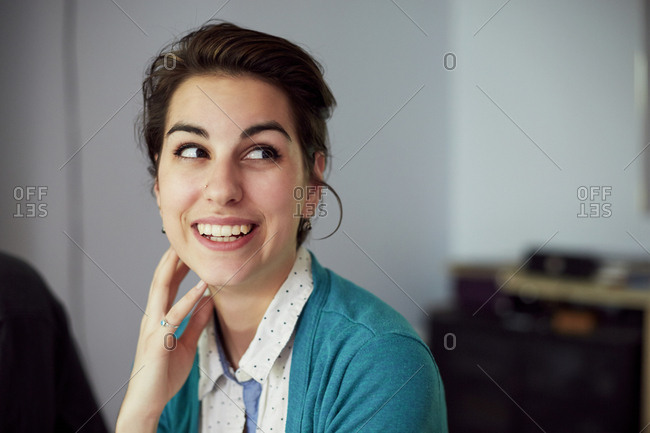 Close up of smiling woman looking up